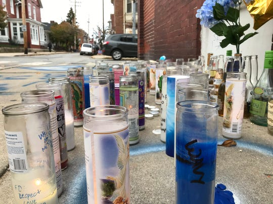 Candles, flowers and messages mark the area where Solomon Moore, 31, of York, was gunned down on Friday night in York.