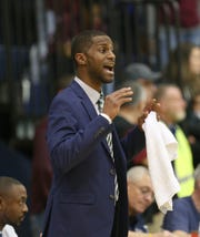 Terry Nowden coaches the Gates Chili boys basketball team in a game against Aquinas in 2018. Nowden was removed as coach last week after he admitted he consumed alcohol on a team trip to a football game in Cleveland.