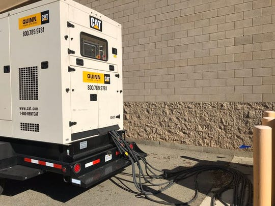 A heavy-duty generator powers the Anderson Walmart through the third PG&E planned power outage in a week in this October 29, 2019 picture.