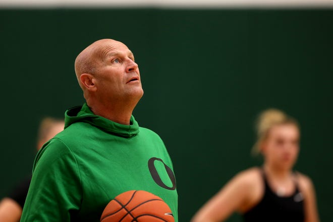 Oregon women's basketball coach Kelly Graves is trying to navigate his team through a season in a pandemic while getting nine newcomers up to speed.