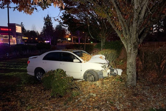 A Salem woman was injured in a crash in McMinnville early Tuesday morning.