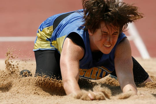 Rochelle High School's Bonnie Richardson lands in the sand pit after an attempt in the Class 1A girls long jump at the state track meet in Austin. Richardson's longest jump was 18 feet, 7 inches, good enough for second place.