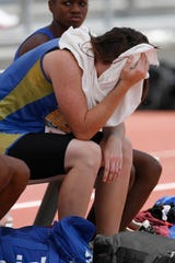 Bonnie Richardson of Rochelle High School takes a moment to herself after the first round of jumps in the Class 1A girls long jump competition at the state meet in Austin.