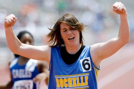 Rochelle High School's Bonnie Richardson pumps her fists in the air after winning the Class 1A girls 200-meter dash at the 2008 state track meet in Austin. Richardson won two gold medals, two silvers and one bronze to single-handedly win the Class 1A girls state team title.