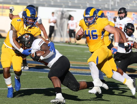 Angelo State University's Darrick Dickerson brings down a UT Permian Basin player as teammate Andy Becker closes in during a game at LeGrand Stadium at 1st Community Credit Union Field on Saturday, Oct. 26, 2019.