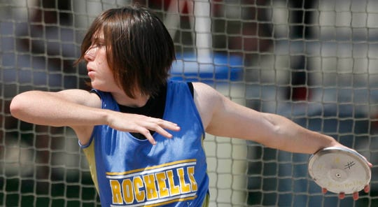Rochelle High School's Bonnie Richardson goes through her pre-throw routine during the Class 1A girls discus competition at the state track meet. Richardson took the bronze medal with a throw of 121 feet.