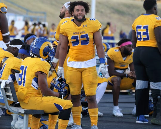 Angelo State University running back Daven Manning, 32, had a career-high three touchdowns in Saturday's win against Adams State. Kaleb King, left, scored twice and had a game-high 112 yards rushing.