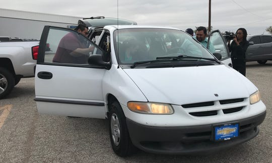 The Gutierrez family enters their 1999 Dodge Grand Caravan for the first time at All American Chevrolet of San Angelo, 203 N. Bryant Blvd., on Monday, Oct. 28, 2019.