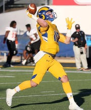 Angelo State University quarterback Payne Sullins prepares to throw a pass against UT Permian Basin at LeGrand Stadium at 1st Community Credit Union Field on Saturday, Oct. 26, 2019.