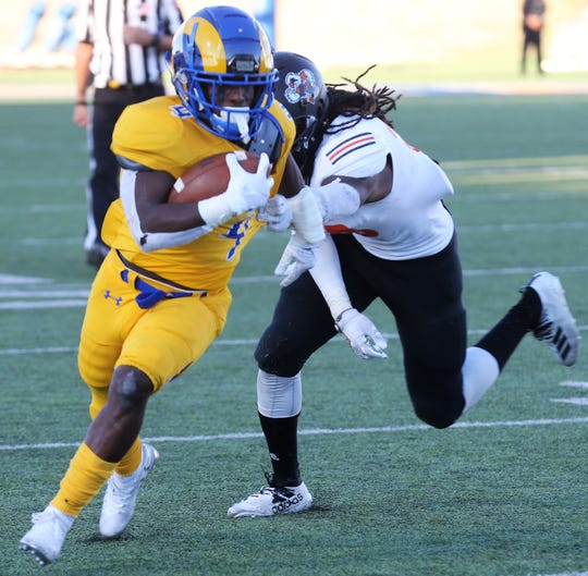 "Angelo State University running back Lloyd ""Bam"" Howard tries to elude a UT Permian Basin player during a game at LeGrand Stadium at 1st Community Credit Union Field on Saturday, Oct. 26, 2019."
