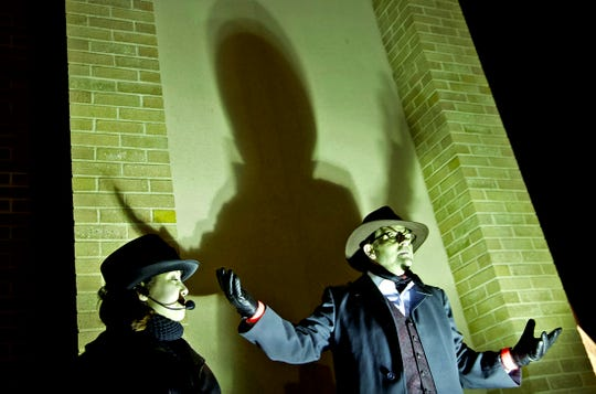 Izabella Dabney, left, and Stoddard Owens, right, lead a ghost walk tour through downtown San Angelo on Thursday, Oct. 24, 2019.