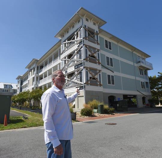 Roger Williams, president of the ownership association at Sunset Island Condominiums in Ocean City, Maryland, talks about water damage/construction issues that they have had with the complex on Aug. 29, 2019. Previous leadership signed an agreement with NVR/Ryan Homes to fix the problems but there are still issues. Here is one of the buildings that is in the process of being fixed.
