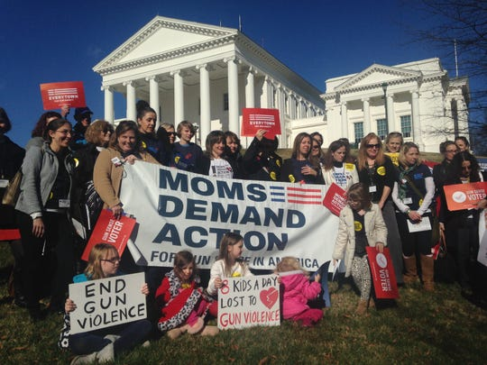 Moms Demand Action supporters rally in support of stricter gun laws and universal background checks.