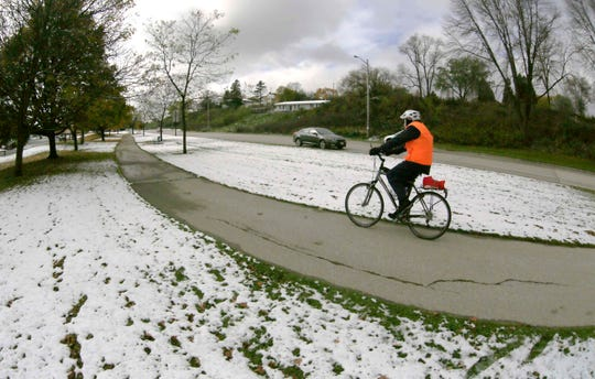 A bicyclist pedals on a path along Maritime Drive, Tuesday, October 29, 2019, in Manitowoc, Wis.