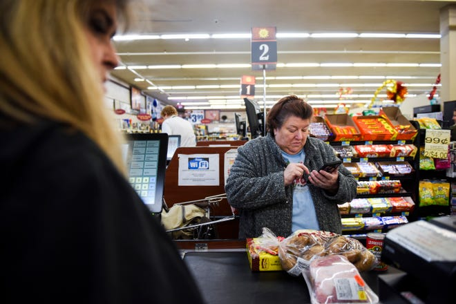 Janet Hentges shops at Sunshine Foods on Tuesday, Oct. 29, 2019. A recently released economic report shows the city's sales tax revenues are growing at the fastest rate experienced in years.