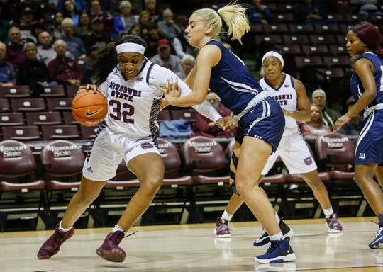 Jasmine Franklin, of Missouri State, moves around Vedrana Radosavljevic, of Lincoln, during an exhibition game at JQH Arena on Monday, Oct. 28, 2019.