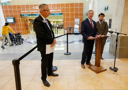 Ken Zellers, center, director of the Missouri Department of Revenue, talks about the Missouri Real ID at the Springfield-Branson National Airport on Tuesday, Oct. 29, 2019, along with Ken Zellers, left, and Joseph Plaggenberg, right.