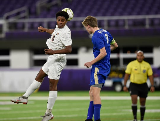 Tech senior Drake Jett fights for a header against Holy Angels Monday, Oct. 28, 2019, at US Bank Stadium for the Class A state semifinals.
