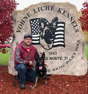 Stevens Point Police Officer J.D. Ballew and his new partner, Alana, pose after meeting at the Vohne Liche Kennels in Denver, Indiana.