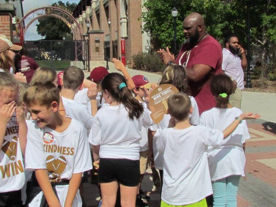Donald Heaven with a Tallahassee grade school class prior to Saturday's FSU-Syracuse football game at Doak Campbell Stadium.