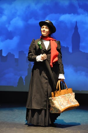 """Mary Poppins (Franchesca Lagos) arrives in London enroute to the Banks home at 17 Cherry Tree Lane in the Young Actors Theatre production of """"Mary Poppins: The Musical."""""""
