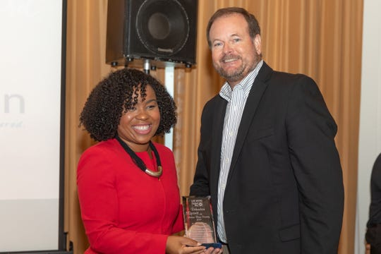 Amber Batchelor, left, presents Ross Cotherman, of Rehmann, with a Richardson Spirit of Indian River County Award at the United Way Community Leaders Breakfast on Oct.17, 2019 at Quail Valley River Club.