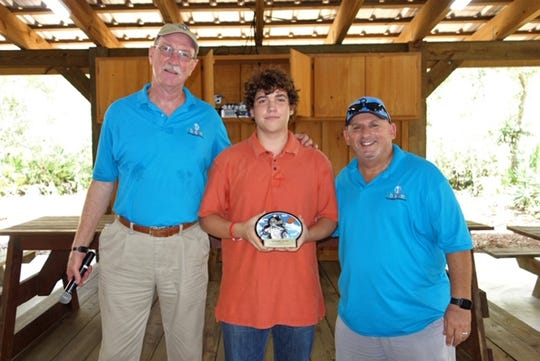 Clays for Kids award winner Andrew Desplaines, center, first place in youth category, with Joe Flanagan, left, and Larry Green.