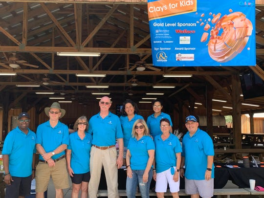 Children's Emergency Resources Board members, from left, Willie Gore Jr., Greg Moody, Laura McBride, Joe Flanagan, Alicia Stover, Debra George, Lisa Kieffer, Sheila Moore and Larry Green at the 2019 Clays for Kids event at Quail Creek Plantation in Okeechobee.