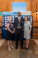 Crossover Mission's Kim Lorimer, left, Antoine Jennings and Cathy De Schouwer, received the Agency Excellence Award at the Indian River County United Way Community Leaders Breakfast on Oct.17, 2019. Crossover Mission is a nonprofit whose mission is to help childrenbecome successful adults through basketball training and academic mentoring.