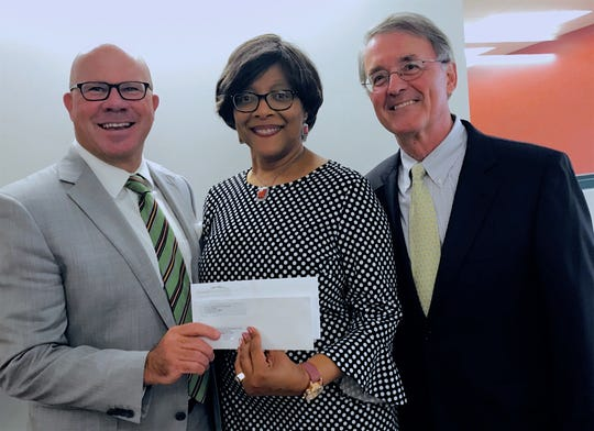 Angelia Perry, center, executive director of the Gifford Youth Achievement Center, accepts the Chairman's Nonprofit Leadership Award of $2,500 from Jeff Pickering, left, president of the Indian River Community Foundation, and Scott Alexander, outgoing Community Foundation board member and a past chairman.