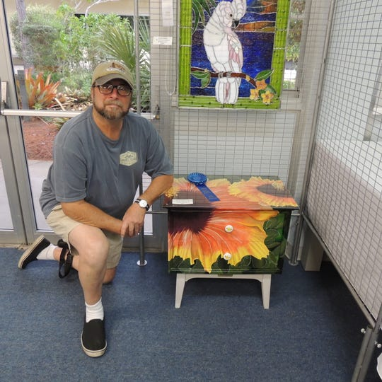 """Floyd Markowitz won first place in Three Dimensional Art for hisfurniture piece """"Flamenco Hibiscus"""" at the Pelican Island Preservation Society's2019 Indian River Bird and Nature Art Show in Sebastian."""