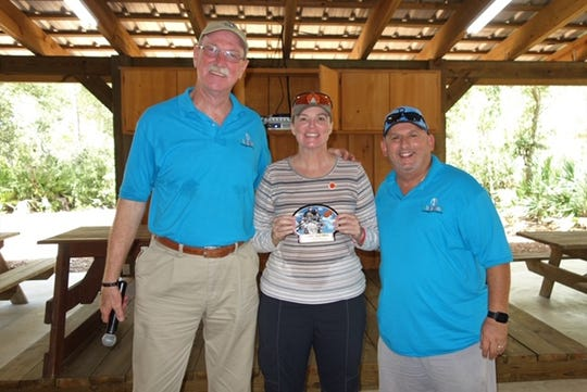 Clays for Kids award winner Sylvia Godbehere, center, first place in female category, with Joe Flanagan, left, and Larry Green.