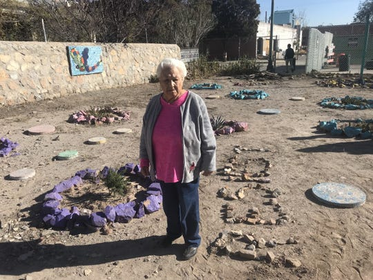 Duranguito resident Toñita Morales, 91, stands on the lot she and others have cared for four years. She is upset the city continues to add fencing around her home.