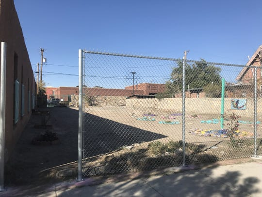 A shot of new fencing installed Monday around an empty lot in Duranguito. Residents say the city is slowly confining them.