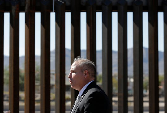In  this file photo, acting Customs and Border Protection Commissioner Mark A. Morgan holds a press conference October 29 in El Paso, Juarez, Chihuahua, Mexico, can been seen through the border fencing.
