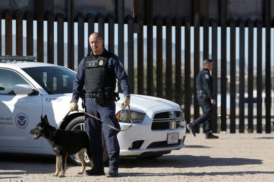 Customs and Border Protection officers gather at the border fence in El Paso, Texas as acting Customs and Border Protection Commissioner Mark A. Morgan held a press conference Tuesday, October, 29, 2019 in El Paso, Texas to deliver fiscal year 2019 immigration and drug seizure numbers.