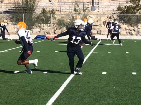 UTEP safety Justin Rogers (13) drops into zone coverage during Tuesday's practice at Glory Field