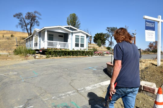 Displaced resident Rich Lohnmann visits his lot at the Seminole Springs Mobile Home Park in Agoura Hills, where has installed a new home but cannot move.