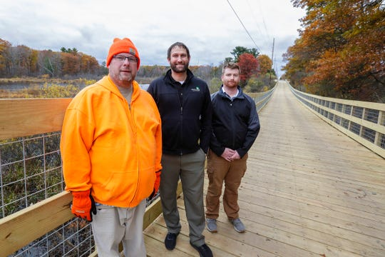 Village trusty Dan Lesniak, left, community development director Randy Fifrick, and director public works Chris Johnson, pose for a photo on the Old Highway 51 Pedestrian Path Thursday, Oct. 24, 2019, in Kronenwetter, Wis. T'xer Zhon Kha/USA TODAY NETWORK-Wisconsin