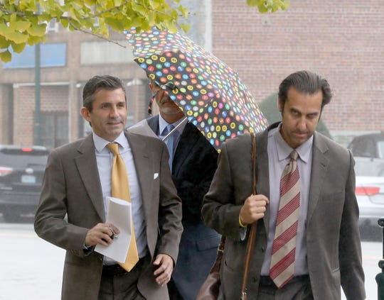 Luiz Aragon, center, the New Rochelle development commissioner, walks with his attorneys David Rifas and Andrew Spatz after his court appearance in New Rochelle Oct. 29, 2019, on harassment charges. Aragon is charged with second-degree harassment after allegedly physically tossing a security guard out of a residents elevator in the Trump Plaza apartment building where he lives.
