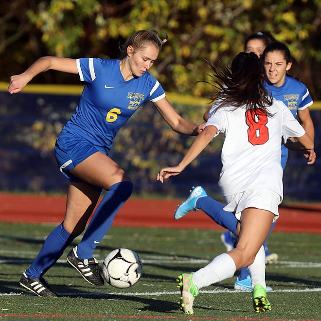 Mahopac's Mia Klammer (6) pushes the ball up the field past Horace Greeley's Lindsay Schwartz (8) during Section 1 Class AA Girls Soccer Quarterfinal game at Mahopac High School on Oct. 28, 2019. Mahopac defeats Hoarce Greely 6-0.