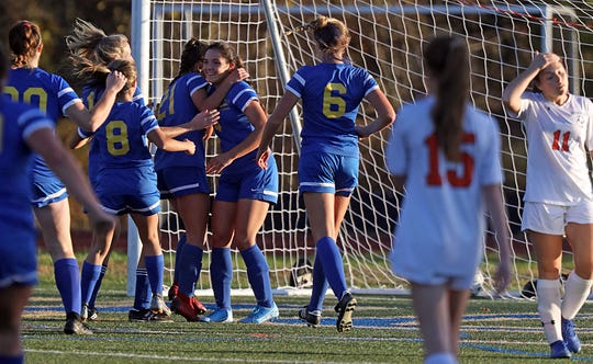 Mahopac's Sabrina Nogula (21) celebrates scoring with her teammates during Section 1 Class AA Girls Soccer Quarterfinal game at Mahopac High School on Oct. 28, 2019. Mahopac defeats Hoarce Greely 6-0.