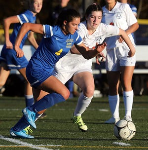 Mahopac's Grace DiVincenzo (4) pushes the ball up the field during Section 1 Class AA Girls Soccer Quarterfinal game at Mahopac High School on Oct. 28, 2019. Mahopac defeats Hoarce Greely 6-0.