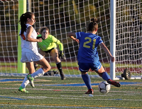 Mahopac's Sabrina Nogula (21) scores during Section 1 Class AA Girls Soccer Quarterfinal game at Mahopac High School on Oct. 28, 2019. Mahopac defeats Hoarce Greely 6-0.