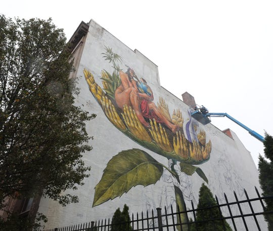 A mural being painted by AEC, at 542 Main Street in New Rochelle Oct. 29, 2019.  On Nov. 2, 2019, there will be an Art Walk through the streets of New Rochelle for the premiere of the NRNY Artsy Murals. The art and the  walk were curated by Street Art for Mankind.