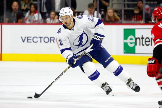 Tampa Bay Lightning's Kevin Shattenkirk (22) moves the puck against the Carolina Hurricanes during the third period of an NHL hockey game, in Raleigh, N.C., Sunday, Oct. 6, 2019. (AP Photo/Karl B DeBlaker)