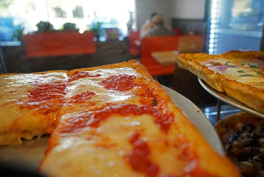 Classic slices of Margherita's Pizza wait for customers visiting the pizzeria's new Newark site in the Park N Shop shopping center on South Main Street.