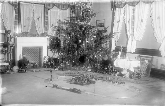 The early evolution of Christmas trees in America involves people ranging from German immigrants to Queen Victoria. Shown here is a typical American tree ca. 1935.