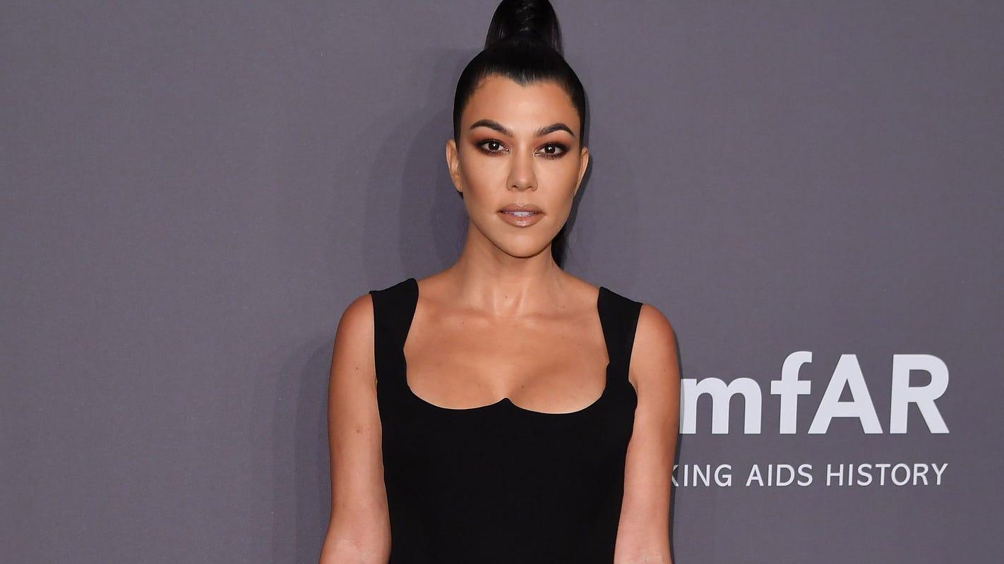 Kourtney Kardashian defends son Reign's long hair: 'He is a happy boy'