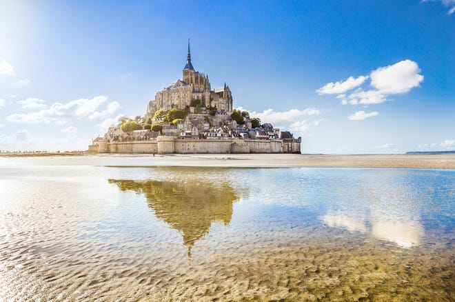 Benedictine monks took up residence at Mont-St.-Michel in 966 A.D., a century before William the Conqueror invaded England. The dramatically pointed island is topped by the Mont-Saint-Michel Abbey,